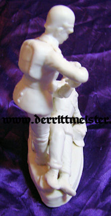 PORCELAIN FIGURINE - SOLDIER AIDING WOUNDED COMRADE - Imperial German Military Antiques Sale