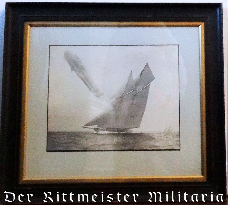 PERIOD-FRAMED PHOTOGRAPH OF ZEPPELINSAILING OVER (ALLEGED) KAISER WILHELM II'S RACING SLOOP S. M. Y. METEOR. - Imperial German Military Antiques Sale