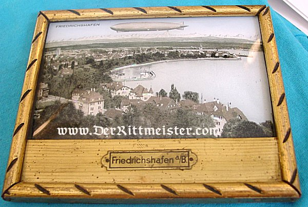 FRAMED HAND COLORED PHOTOGRAPH OF FRIEDRICHSHAFEN WITH A ZEPPELIN - Imperial German Military Antiques Sale